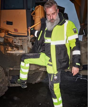 Pantaloni de lucru Helly Hansen ICU Construction, reflectorizanti, HVC2, galben/negru, din profil seara