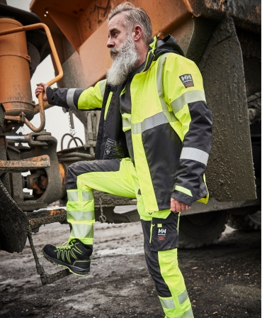 Geaca de iarna cu gluga Helly Hansen ICU Winter, impermeabila, reflectorizanta, HVC2, 3, galben/negru, pe muncitor, profil