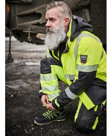 Ghete protectie Helly Hansen Addvis Mid, S3, SRC, negru/galben, pe muncitor, din profil